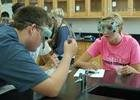 Students in a chemistry science classroom with safety goggles on