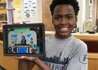 Student holding up iPad